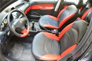 اسپرت 206 فرمان چرم , رودری چرم مشکی  و قرمز , روکش صندلی قرمز  مشکی با دوخت قرمز ( سفارشی)